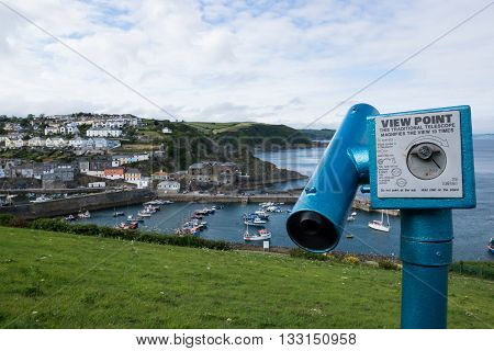 Telescope and view of Mevagissey Cornwall England