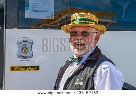 Napier New Zealand - November 19 2014: Guide greets visitors on the port of Napier in North Island - New Zealand