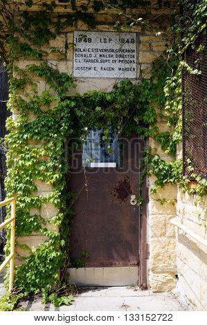 JOLIET, ILLINOIS / UNITED STATES - MAY 3, 2015: The door to the visitor's center of the old Illinois State Penitentiary, now vacant and abandoned.