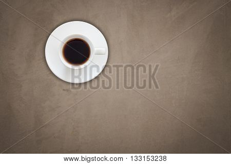 Top view of coffee cup on gray concrete texture background