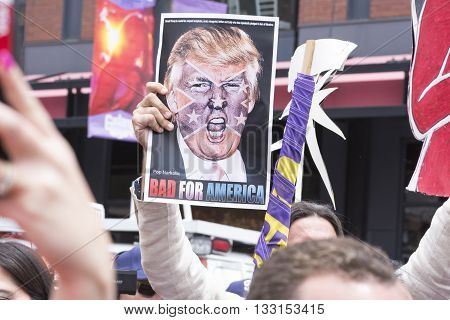 SAN DIEGO USA - MAY 27 2016: A protester holds a sign featuring an angry photo of Donald Trump and reading