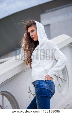 urban young woman in casual clothes portrait in the city