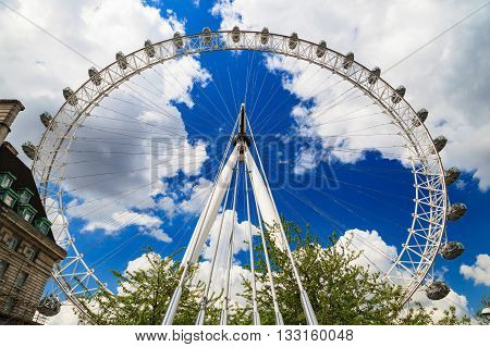 LONDON UNITED KINGDOM - 23 MAY 2016: London Eye is the tallest Ferris wheel in Europe Big Ben and Country Hall in London United Kingdom
