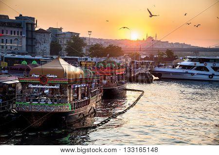 ISTANBUL TURKEY - MAY 23 2016: fishermen boat restaurant produce famous fish sandwiches near Galata Bridge Istanbul Turkey