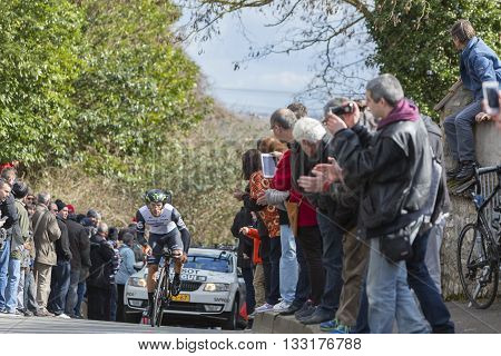 Conflans-Sainte-Honorine,France-March 6,2016: The Algerian cyclist Youcef Reguigui of Dimension Data Team riding during the prologue stage of Paris-Nice 2016.