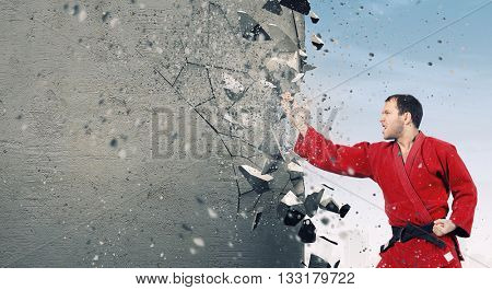 Man in kimono breaking wall