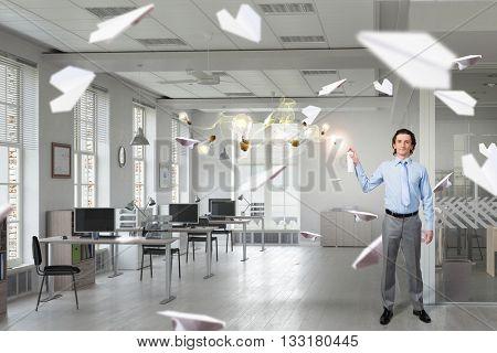 Businessman with aerosol can