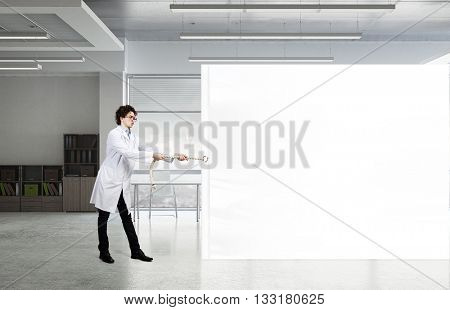 Funny doctor with billboard