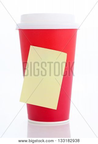 Coffee to go. Paper coffee cup with blank yellow stick note