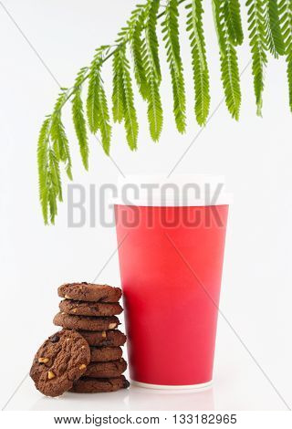 Blank paper cup and chocolate biscuits on white background