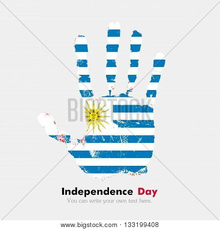 Hand print, which bears the Flag of Uruguay. Independence Day. Grunge style. Grungy hand print with the flag. Hand print and five fingers. Used as an icon, card, greeting, printed materials.
