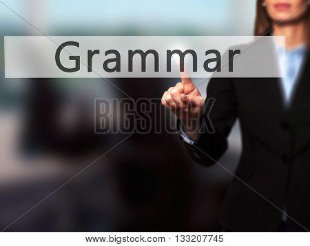 Grammar - Businesswoman Hand Pressing Button On Touch Screen Interface.
