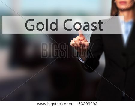 Gold Coast - Businesswoman Hand Pressing Button On Touch Screen Interface.