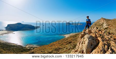 panoramic view on Balos beach, Crete, Greece. Man, traveller and photographer stands on the cliff