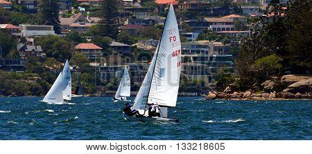 Sydney, Australia - Jan 8, 2015: German team (GER16: KEIL, Karsten and HAPPICH, Michael Frank) in Sydney Harbour. Flying Dutchman World Championship was held in Sydney in 2015.