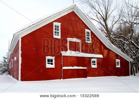 red barn in white snow
