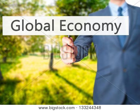 Global Economy - Businessman Hand Holding Sign