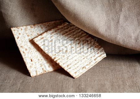 Seder concept. Still life with matzoh on old canvas background