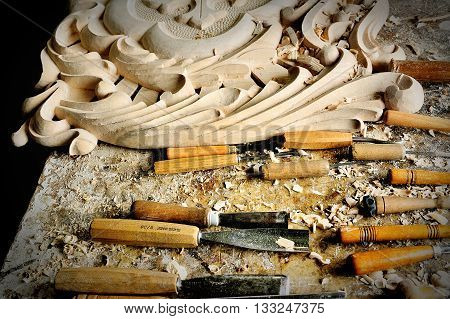 chisel and cutting wood in carver workshop