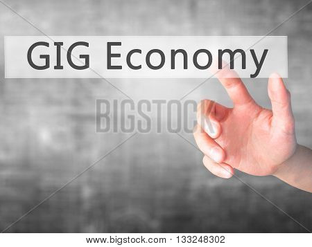 Gig Economy - Hand Pressing A Button On Blurred Background Concept On Visual Screen.