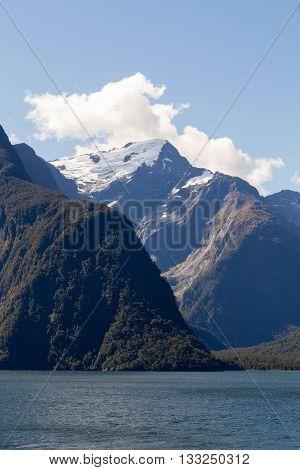 Mountains wih snow cap on Fjorland coast New Zealand