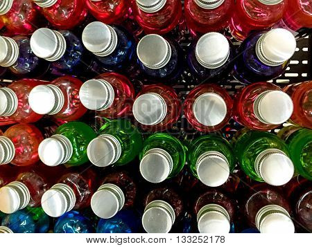 Glass color bottles cover abstract background .