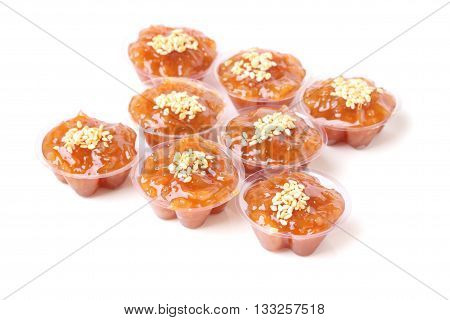 Focus buttom right of group brown flavored sweet translucent gelatinous rice.