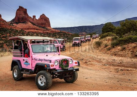 SEDONA, ARIZONA, DECEMBER 28, 2014: Caravan of Pink Jeep Tours vehicles on Schnebly Hill Road (formerly historic Munds Trail) connecting Sedona and Flagstaff