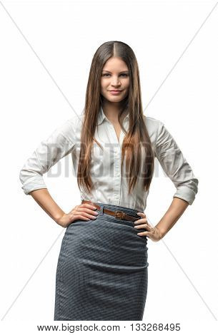 Pretty business woman looks directly at the camera pleasantly smiling. Cutout portrait. Successful lifestyle. Business staff. Office clothes. Dress code. Presentable appearance. Beauty and youth.