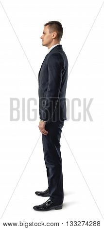 Side view of businessman standing, isolated on white background. Successful lifestyle. Business staff. Office clothes. Dress code. Presentable appearance. Self-confidence.