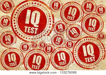 iq test, red stamp on a grunge paper texture