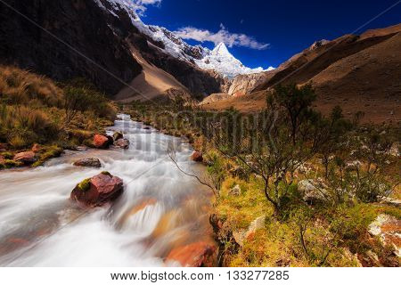 Mountain landscape in the Andes, Peru, Cordiliera Blanca, with Alpamayo peak in the background