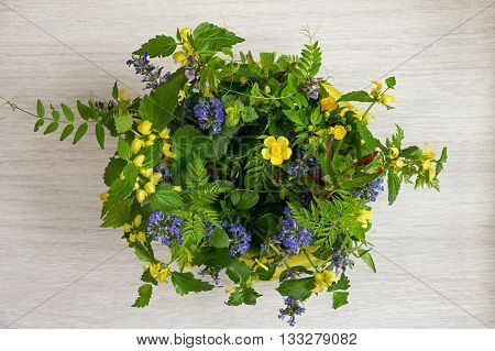 Vase with spring wildflowers. The top view.