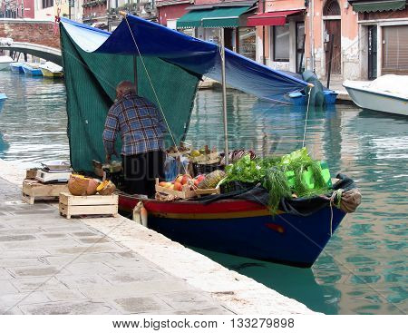 Floating greengrocer at Venice , Italy .