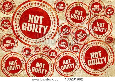 not guilty, red stamp on a grunge paper texture