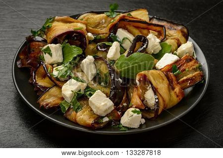 Appetizer - delicious salad with  grilled eggplants with feta cheese, parsley and ruccola.