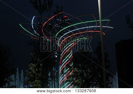 MILAN, ITALY - OCTOBER 12 2015: View at night of Tree of Life monument at Expo 2015 universal exhibition in Milan lighted with the colours of Italian flag on October 12 2015