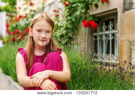 Fashion stylish portrait of pretty preteen girl of 8-9 years old, wearing maroon jumpsuit