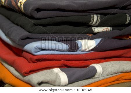 Stack Of Folded Clothes With A Variety Of Color