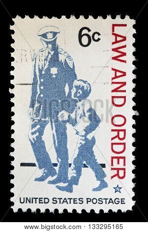 United States Used Postage Stamp Showing Policeman With A Boy