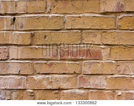 Textured background closeup. Reddish brown old brick wall abstraction