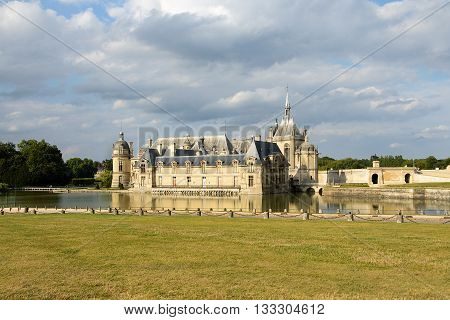 Chantilly France- August 08 2013: Chateau de Chantilly ( Chantilly Castle ) located in the town of Chantilly France. The Chateau consists of two buildings: Petit Chateau (built in 1560) and Grand Chateau (was destroyed during the French Revolution and reb