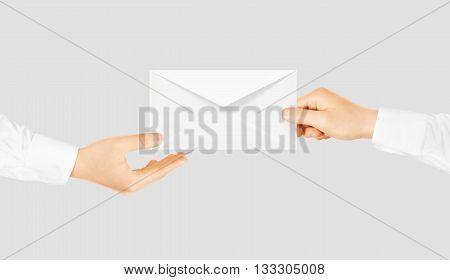 White blank envelope giving hand. Message send presentation. Person taking clear envelope email mockup. Post shipping delivering. Sharing mail message. Sending message men.