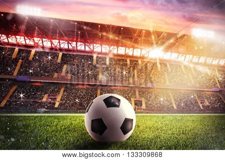 Soccerball on the lawn of a stadium