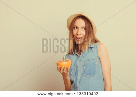 Happy glad woman tourist in straw hat drinking grapefruit juice. Healthy diet food. Weight loss. Summer vacation holidays..