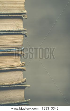 Image of many antique books piled together