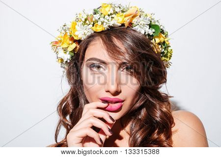 Close-up portrait of a beautiful attractive sexy girl wearing flower diadem diadem isolated on the white background