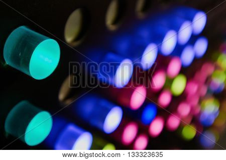 Light emitting diodes in color led handle buttons. focus is on foreground