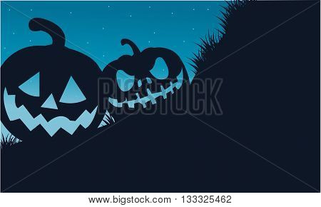 Silhouette of two pumpkins Halloween scary at night