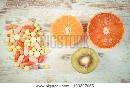 Vintage Photo, Fresh Fruits And Colorful Medical Pills, Choice Between Healthy Nutrition And Medical